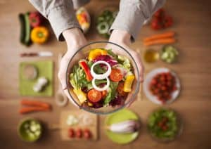 healthy organic food on a budget woman holding salad